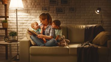 "Mother reading to her children, using ""task lighting"""