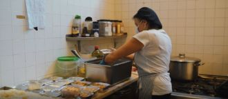 Meal preparation in the kitchen of CASA